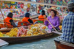 Ratchaburi / Thailand - April 21 2018:People sale fruit as banana in the boat at floating market. Royalty Free Stock Photo