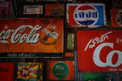 Rust old wall vintage logo of soft drinks. Ratchaburi, Thailand - December 4: Rust old wall vintage logo of soft drinks in Ratchaburi, Thailand Stock Photos