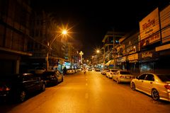 Ratchaburi, Thailand: January 17, 2014 - Landscape of downtown at night in the rural area. Perspective picture of local street at royalty free stock photo