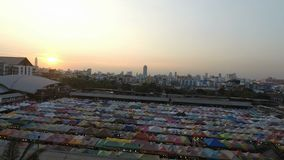 Ratchada Night Train market, Bangkok, Thailand - Circa February 2018: Colorful tents on a local market in bangkok at afterno. Ratchada Night Train market stock video