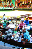 RATCHBURI, THAILAND. AUGUST 19 : Unidentified tourists and vendors in Damnern Saduak floating market on August 19, 2007 in Stock Image