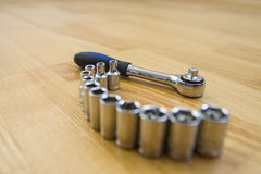 Ratchet with bits. Ratchet on the wooden floor Royalty Free Stock Photos