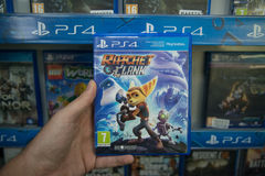Ratchet and Clank. Bratislava, Slovakia, circa april 2017: Man holding Ratchet and Clank videogame on Sony Playstation 4 console in store Royalty Free Stock Image