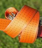 Ratchet lashing strap. Orange colored ratchet lashing strap Royalty Free Stock Images