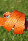 Ratchet lashing strap. Orange colored ratchet lashing strap Stock Photos