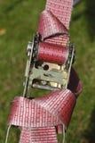 Ratchet lashing strap. Pink colored ratchet lashing strap Royalty Free Stock Image