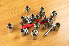 Ratchet and a set of different attachments to tighten the bolts Stock Photography