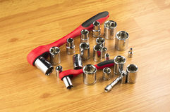 Ratchet and a set of different attachments to tighten the bolts Stock Photos