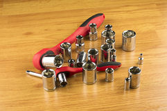 Ratchet and a set of different attachments to tighten the bolts Stock Images