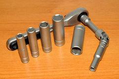 Ratchet Socket Set. Ratchet and socket set with a wood background Royalty Free Stock Images