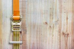 Ratchet strap on wood background.  stock image