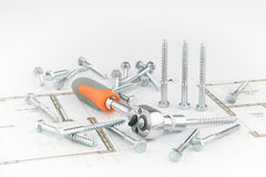 Ratchet wrench, screws on an architectural sketch Stock Photo