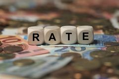 Rate - cube with letters, money sector terms - sign with wooden cubes Stock Image