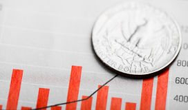 Rate of the dollar. American coin on fluctuating graph. Rate of the dollar (shallow DOF Royalty Free Stock Photos