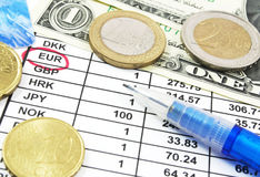 Rate of exchange. With euro coins and dollar bills stock photography