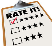 Rate It Stars Reviews Feedback Clipboard. The words Rate It on a clipboard with stars next to ratings or reviews, and a checkmark in a box next to 5 star Royalty Free Stock Photography