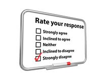 """Rate your response. Notice board with black text """"Rate your response"""" with five options listed below and """"strongly disagree"""" ticked with a red pen Royalty Free Stock Photography"""