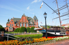 Rathaus and museum ship Friederike in Papenburg, Germany. The historic red brick rathaus (town hall) and museum ship Friederike in a canal in Papenburg, Germany stock photo