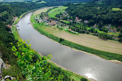 Rathen near Bastei in saxony. Look from the bastei in saxon sandstone mountains onto little town Rathen and river elbe Royalty Free Stock Photos