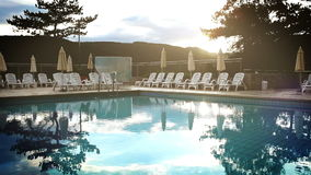 A rather cold footage of a pool in the luxury resort in autumn.  stock video footage
