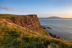 Rathlin Island cliffs at sunset. Rathlin is an island off the coast of County Antrim and the northernmost point of Northern Ireland royalty free stock images