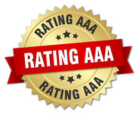 Rating aaa 3d gold badge. With red ribbon Stock Images