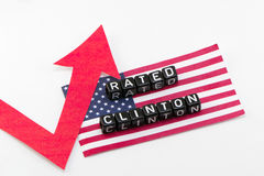 Rating Clinton grows phrase. On flag background Royalty Free Stock Images