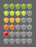 Rating shields. Security rating glossy shields on grey background Royalty Free Stock Photo