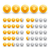 Rating stars on glossy gold spheres Stock Photo