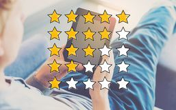 Rating Theme with man using a tablet stock images