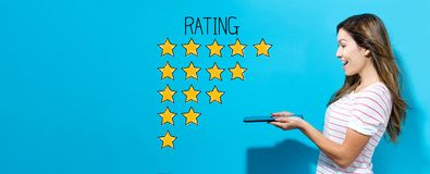Rating theme with woman using a tablet. Rating theme with young woman using her tablet royalty free stock image
