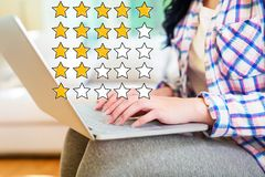 Rating Theme with woman using a laptop royalty free stock photo