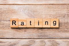 Rating word written on wood block. Rating text on wooden table for your desing, concept.  royalty free stock photo