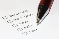 Ratings. Unmarked checkboxes of a survey with ratings. With pen royalty free stock image