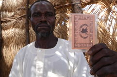 Ration Card in Darfur. August 17, 2004 - A displaced man holds up a UN ration card at the Riyad displaced camp in  East Darfur, Sudan Stock Images