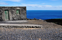 Rational Cape Verdean home by the road Stock Image