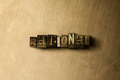 RATIONAL - close-up of grungy vintage typeset word on metal backdrop Stock Images