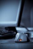 Rato do computador com o vermelho conduzido Imagem de Stock Royalty Free