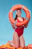 Ratownik kobieta na obowiązku z ringowy boja lifebuoy Obrazy Royalty Free