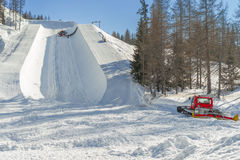 Ratrak making half pipe slope for snowboard and ski Royalty Free Stock Photo