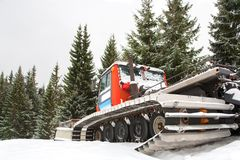 Ratrak or Snowcat, specialized vehicle for snow. Winter landscape of ski resort Stock Photography