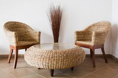 Rattan. Patio furniture against a white wall Stock Photography