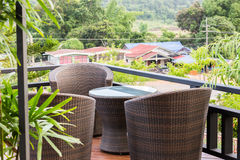 Rattan armchair and table on mountain view terrace. Rattan armchair furniture on mountain view terrace Stock Photos