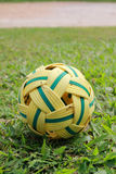 Rattan ball on grassland. The rattan ball is on the wet grassland Stock Photography