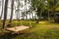 Rattan bamboo hammock hanging on tree Royalty Free Stock Photos