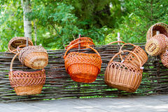 Rattan basket hanging on a wooden fence Stock Photography