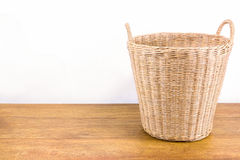 Rattan basket on wood floor. Empty rattan basket on wood floor and concrete wall background Stock Images