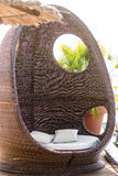 Rattan beach hut. Photo closeup of rattan beach hut egg-shaped summer day bed couch with flock and cushions for sun protection lounge relaxing atmosphere on Royalty Free Stock Images