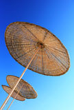 Rattan Beach Umbrella Stock Photo