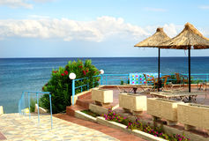 Rattan beach umbrellas on a beach Royalty Free Stock Photo
